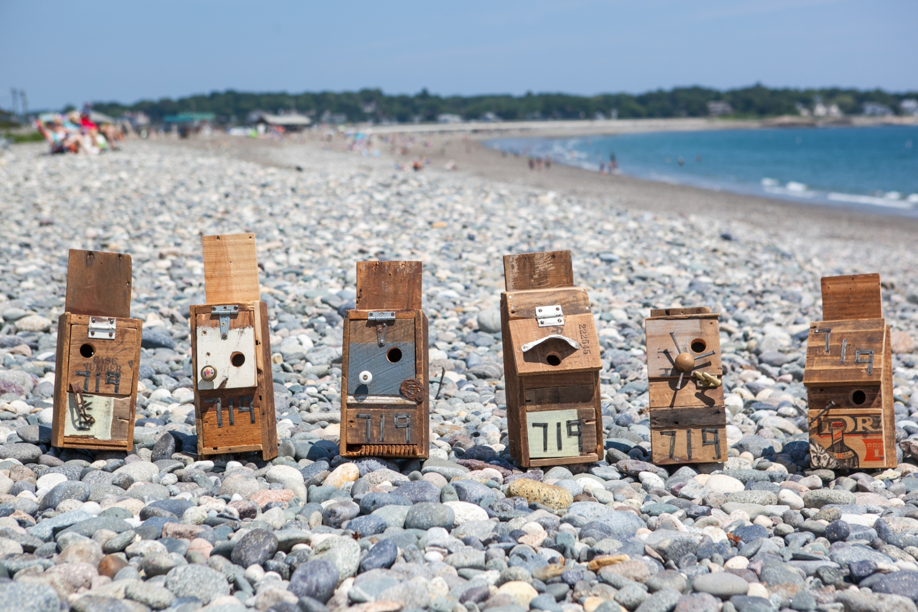 Hand made birdhouses crafted from recycled shipping crates and found material by Nate Fried-Lipski