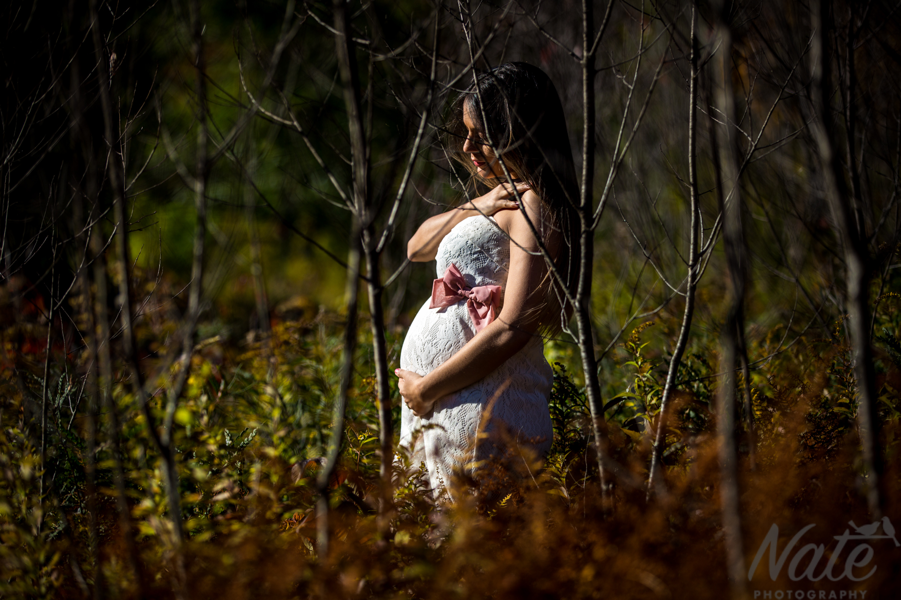 Rich and Amanda maternity photos at Martin Burns Wildlife Management Area. by Nate Photography
